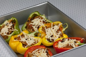Enchilada Stuffed Peppers with Quinoa and Soy Curls