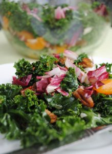 Delicious, fruity kale salad with mandarin oranges, cranberries, and candied pecans | www.thatwasvegan.com